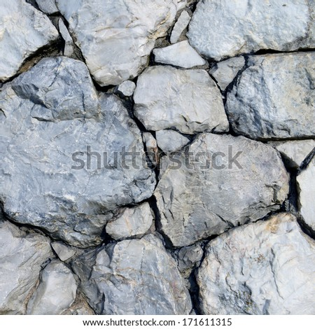 Closeup of stone wall background and texture - stock photo