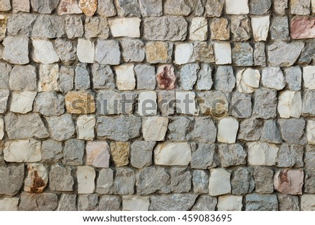 closeup of stone wall with grey stones