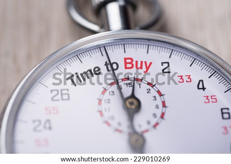 Closeup of stopwatch showing Time to Buy concept - stock photo
