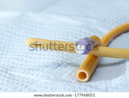 Closeup of straight catheter on sterile field. - stock photo