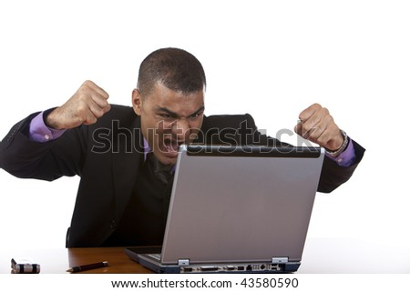 Closeup of stressed businessman which is angry in his office, because his computer has a crash. Isolated on white. - stock photo