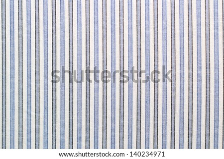 closeup of striped ( blue and black ) fabric - shirt material - stock photo
