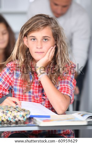 Closeup of student girl in classroom - stock photo
