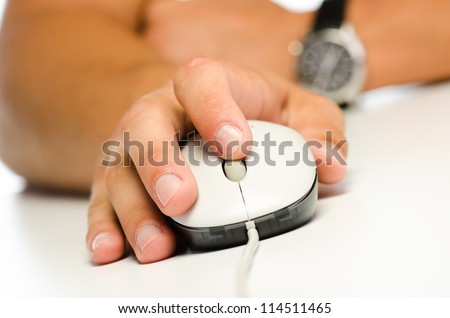 Closeup of student's hand using computer mouse - stock photo