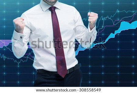 Closeup of successful portfolio manager in white shirt with pumped fists. A concept of the celebrating of success. Forex chart on the background. - stock photo