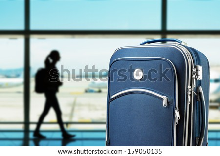 Closeup of suitcase at the airport - stock photo