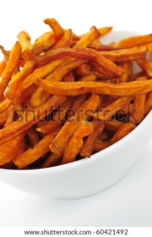 Closeup of sweet potato or yam fries in white bowl - stock photo