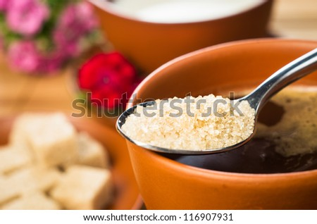 closeup of tablespoon with brown sugar - stock photo