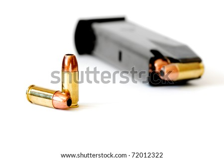 Closeup of tactical military bullets and magazine for gun - stock photo