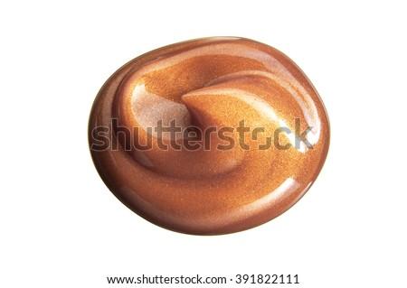 Closeup of tanning gel blob on white background - stock photo