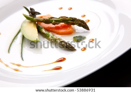 Closeup of Tapas Salad appetizer with avocado, asparagus, papaya, chocolate mint and chives. - stock photo