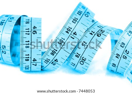 Closeup of tape measure on white background. - stock photo