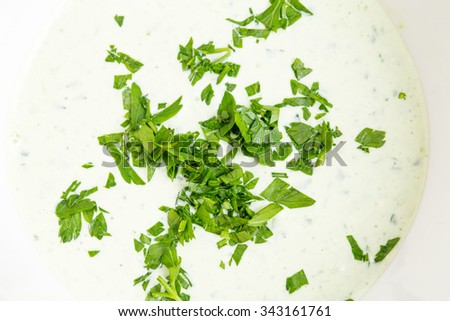 Closeup of tartar sauce with fresh chopped herbs. Macro. Photo can be used as a whole background. - stock photo