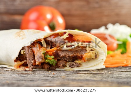 Closeup of tasty kebab with beef and vegetables - stock photo