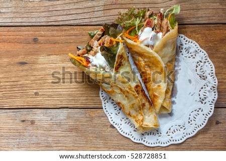 Closeup of tasty kebab with beef and vegetables, Top view on old wood background