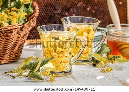 Closeup of tea with lime and honey - stock photo