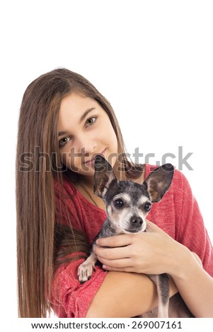 Closeup of teenage girl holding a cute chihuahua dog on white background