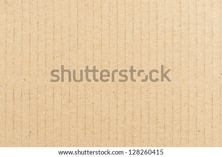 Closeup of textured recycled cardboard with natural fiber parts - stock photo