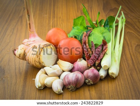 Closeup of Thai ingredients, galangal, lime, lemongrass,tomato, chilli, garlic and lime leaves - stock photo