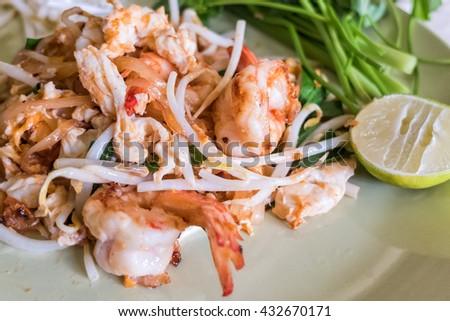 Closeup of Thai stir-fried rice noodles with fresh shrimp Pad Thai / Phat Thai - stock photo