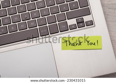 Closeup of Thank You ! sticky note message on laptop - stock photo