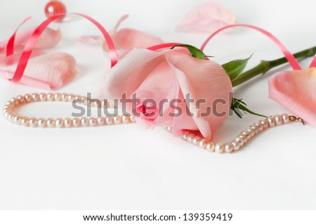 Closeup of the beautiful rose and pearls