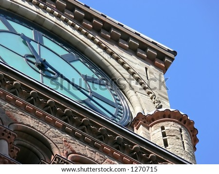 Closeup of the clock on Old City Hall, Toronto. - stock photo