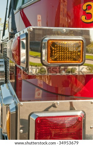 Closeup of the corner of a bright red firetruck. - stock photo