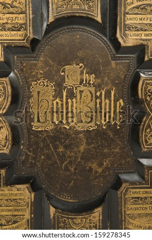 Closeup of the cover text on an antique bible - stock photo