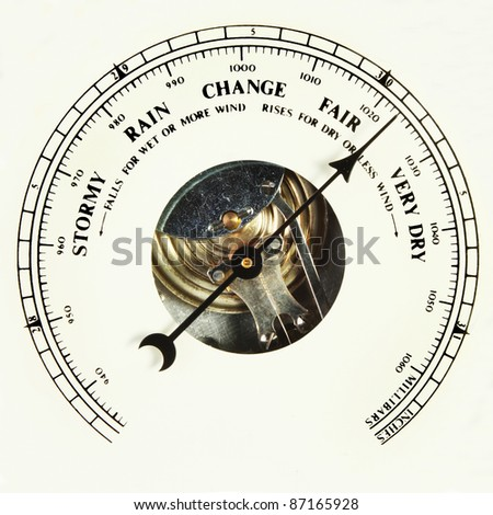 Closeup of the dial of an aneroid barometer set to fair - stock photo