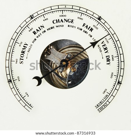 Closeup of the dial of an aneroid barometer set to very dry - stock photo