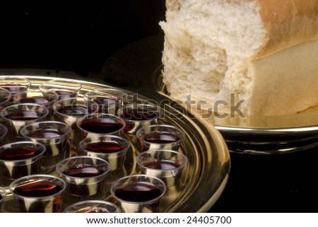 Closeup of the elements - bread and wine - used in Christian communion - stock photo