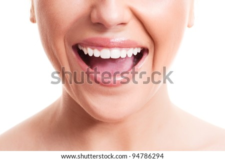 closeup of the face of a young woman with healthy white teeth, isolated against white background