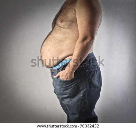 Closeup of the fat body of a man - stock photo