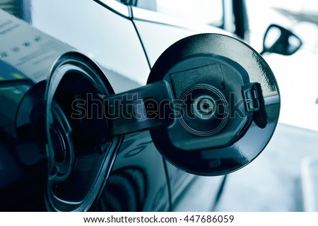 closeup of the fill cap of the fuel tank of a car - stock photo