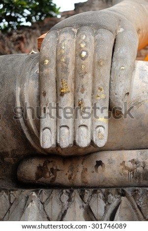 Closeup of the fingers of a Buddha statue - stock photo