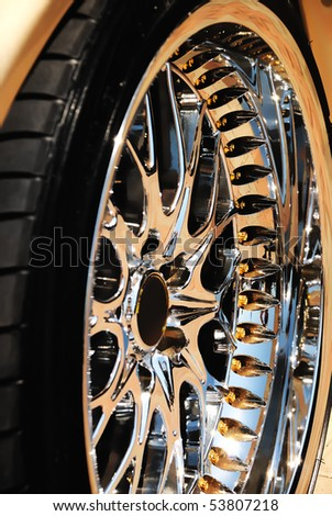 Closeup of the golden wheel and tyre cover - stock photo