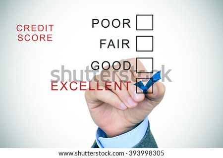 closeup of the hand of a man in suit marking excellent from a list of the different ranges of the credit score: excellent, good, fair and poor