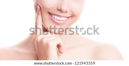 closeup of the healthy white teeth of a woman, isolated against white background - stock photo