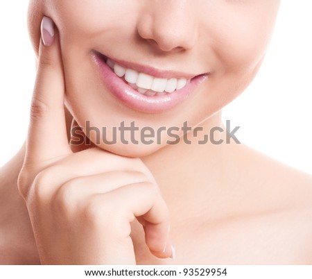 closeup of the healthy white teeth of a woman, isolated against white background, copyspace for your text to the right - stock photo