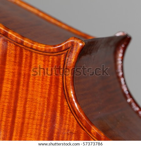 Closeup of the inlay work on an antique cello - stock photo