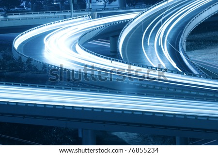 closeup of the light trails on grade separation bridge - stock photo