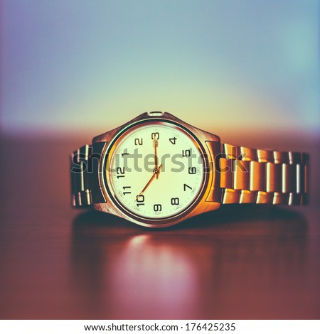 Closeup Of The Men's Wrist Watch. Toned Instant Photo - stock photo