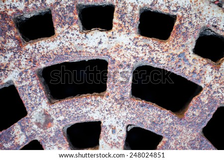 Closeup of the metal manhole cover surface. - stock photo