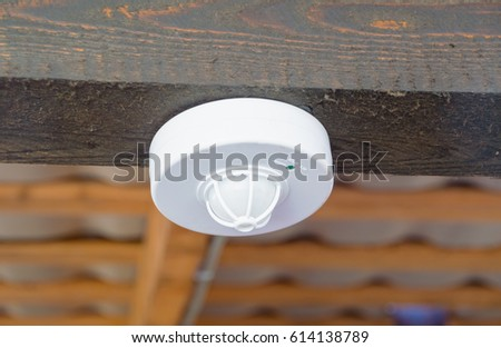 closeup of the motion sensor and smoke under the roof.