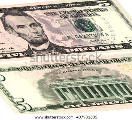 closeup of the obverse and reverse sides of the banknote in a five dollars isolated on white with Clipping Path.