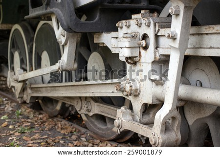 Closeup of the old rusty train wheels - stock photo