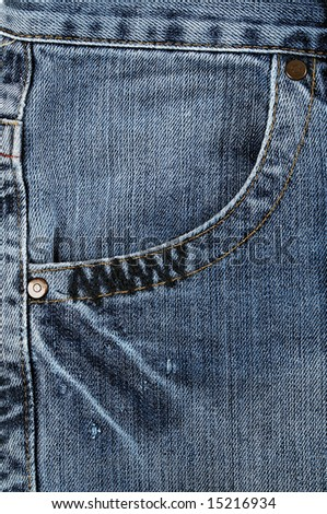 Closeup of the pocket of blue jeans - stock photo