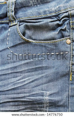Closeup of the pockets of blue jeans - stock photo