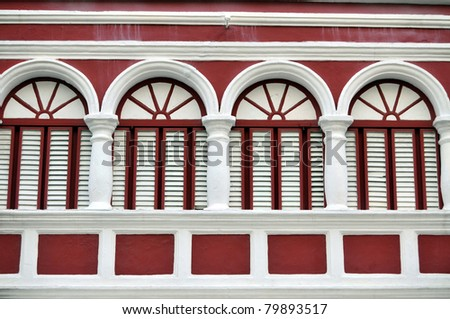 Closeup of the red facade of a colonial house in Willemstad, the capital of Curacao, in the Caribbean. Downtown Willemstad is a UNESCO World Heritage Site. - stock photo
